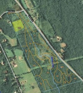 Aerial view showing NRCS Soil types - orchard location in yellow on upper left.