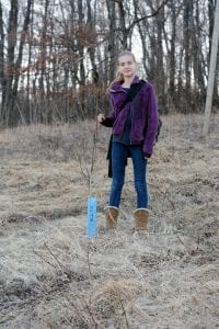 Young conservationist shows off one of our seedlings
